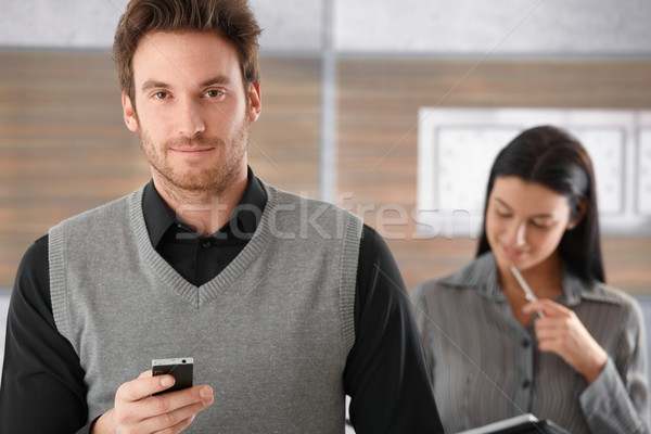 Portrait of goodlooking businessman with mobile Stock photo © nyul