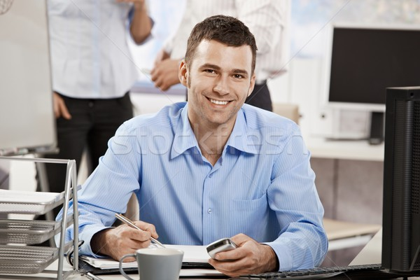 Stock photo: Young businessman working in office