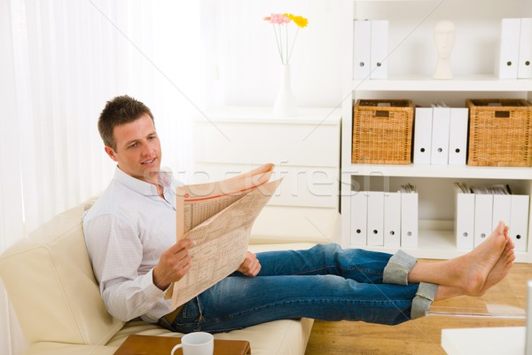 Man reading newspaper on couch Stock photo © nyul