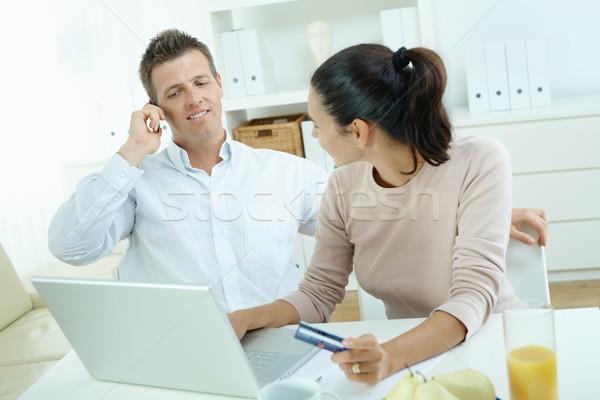 Pár vásárlás internet fiatal pér ül asztal Stock fotó © nyul