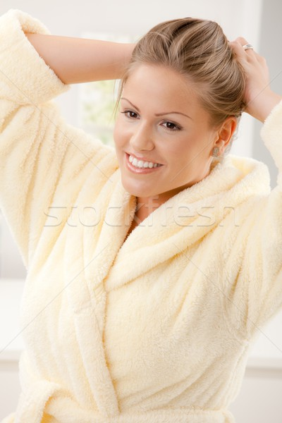 Jonge vrouw badjas portret gelukkig Geel Stockfoto © nyul
