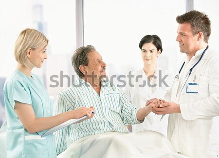 Nurse examining blood pressure for patient Stock photo © nyul