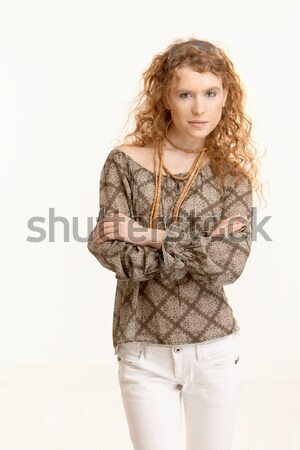 Attractive young woman standing arms crossed Stock photo © nyul