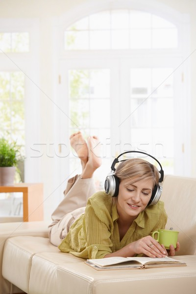 Woman resting on couch at home Stock photo © nyul