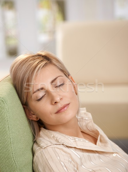Woman napping in armchair at home Stock photo © nyul