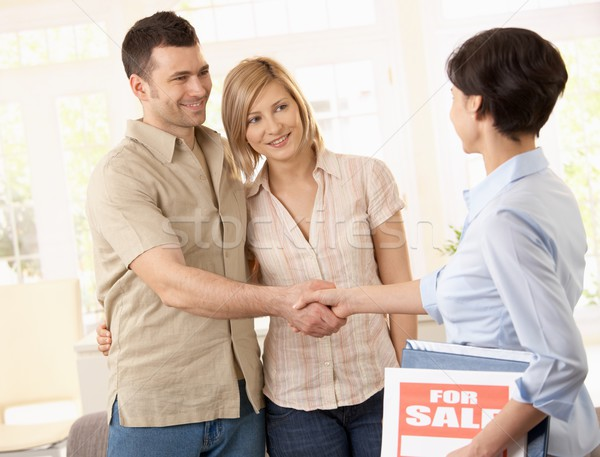 Estate agent congratulating couple Stock photo © nyul