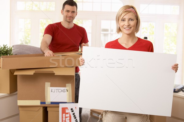 Smiling couple unpacking in new place Stock photo © nyul