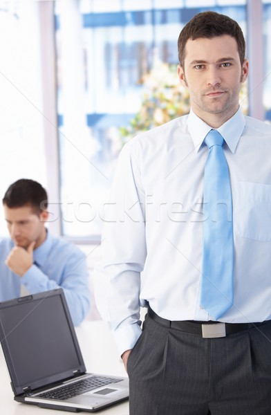 Confident businessman standing in office Stock photo © nyul