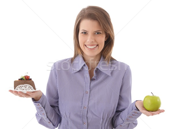 Happy woman offering cake and apple Stock photo © nyul