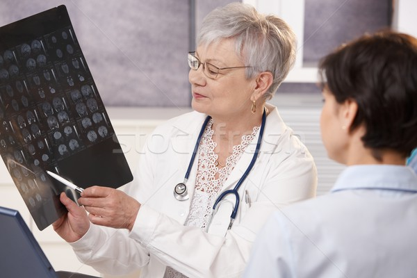 Doctor and patient discussing x-ray results. Stock photo © nyul