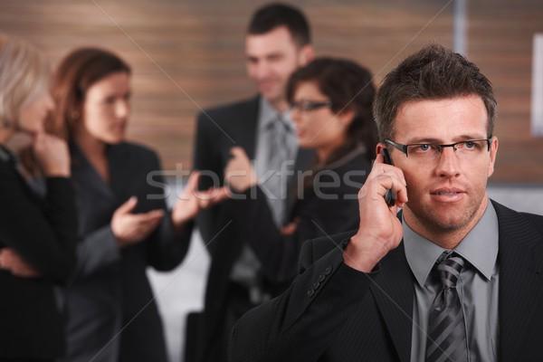 Empresário telefone retrato falante telefone móvel pessoas de negócios Foto stock © nyul