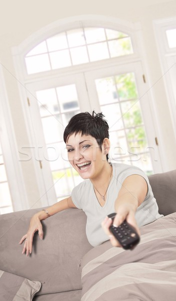 Young woman with TV remote Stock photo © nyul