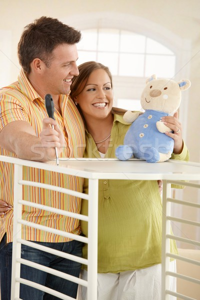 Expectant couple smiling at toy Stock photo © nyul