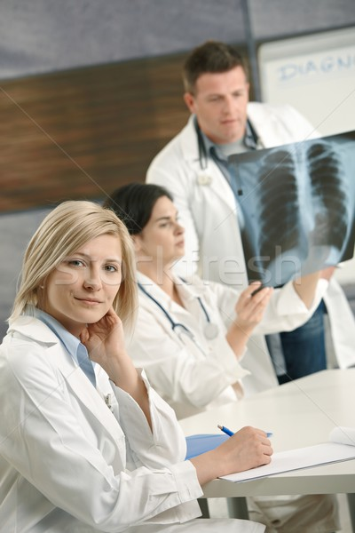 Doctors consulting diagnosis Stock photo © nyul