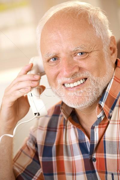 Older man on landline phone call Stock photo © nyul