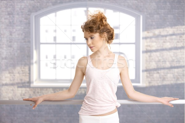 Pretty dancer standing by bar practicing Stock photo © nyul