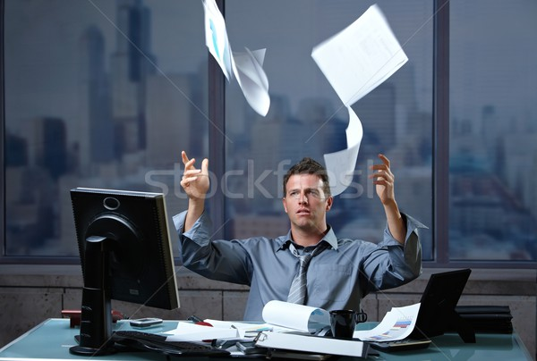 Stock photo: Professional throwing documents into air