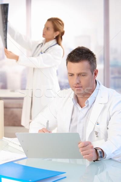 ハンサム 医師 作業 オフィス 女性 勉強 ストックフォト © nyul