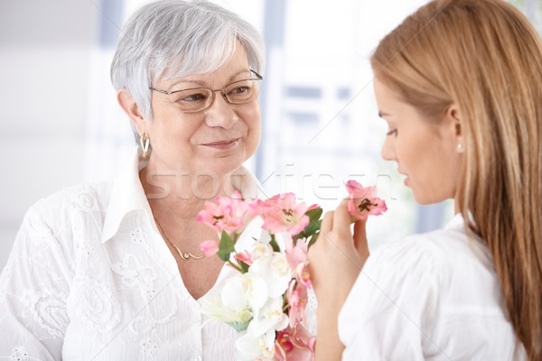 Mature mother and young daughter with blossom Stock photo © nyul