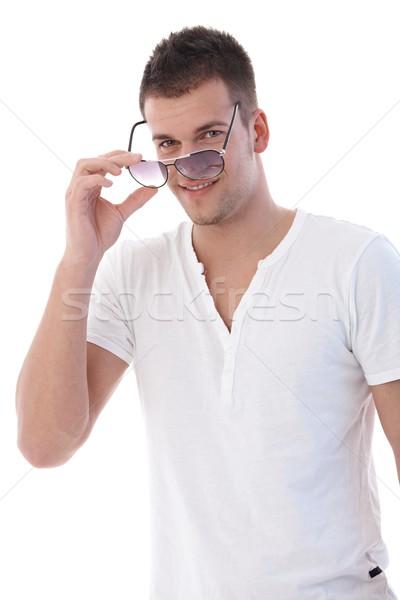 Zdjęcia stock: Młody · człowiek · okulary · uśmiechnięty · kamery · twarz · lata