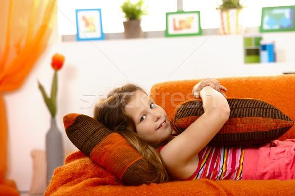 девочку диване глядя камеры подушкой Сток-фото © nyul