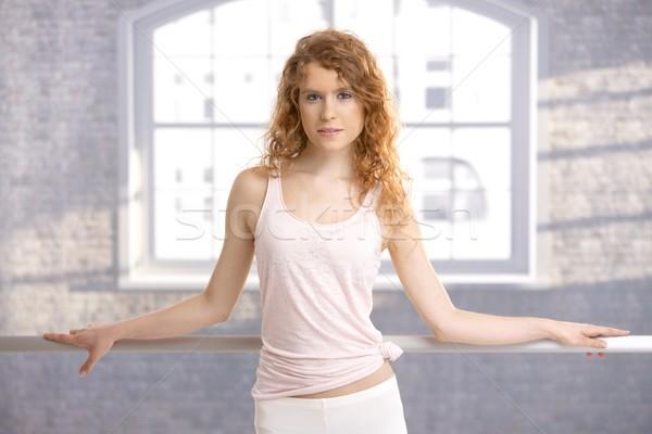 Stock photo: Pretty dancer standing by bar in studio