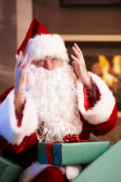 Santa looking troubled having too much work Stock photo © nyul