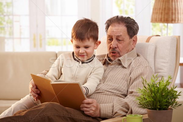 Grandfather reading book to grandson Stock photo © nyul