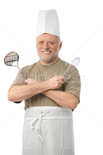 Senior cook with kitchen utensils  Stock photo © nyul