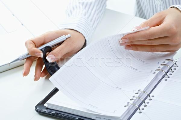 Woman turning notebook page Stock photo © nyul