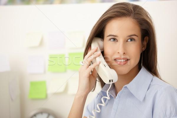 Portrait of woman on landline call Stock photo © nyul