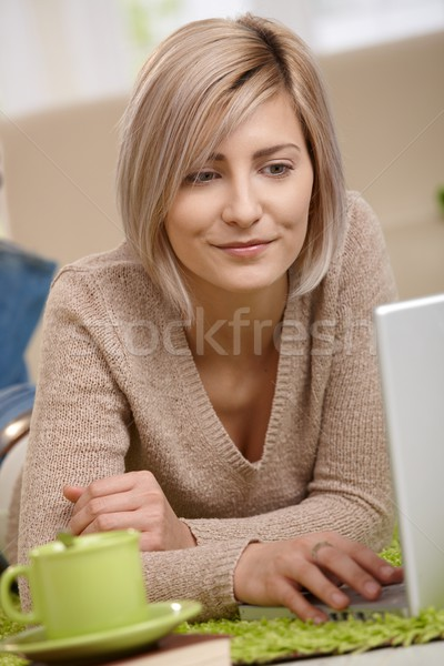 Portrait of young woman with laptop Stock photo © nyul