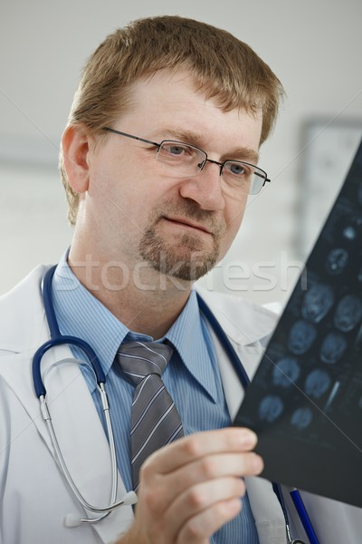 Doctor looking at medical scan Stock photo © nyul