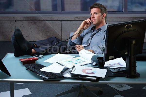 Сток-фото: бизнесмен · вызова · ног · вверх · устал