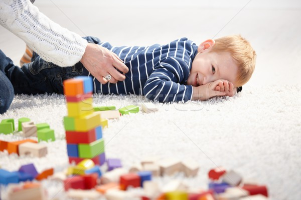 Stock photo: Toddler smiling tickled by mother