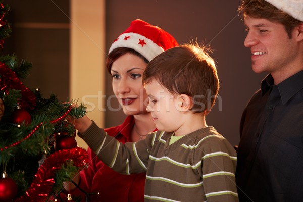 Stock photo: Family at christmas tree