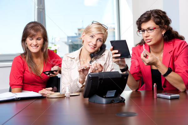 Businesswomen adjusting makeup Stock photo © nyul