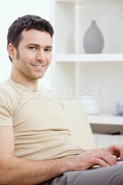 Happy man using computer Stock photo © nyul