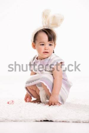 Baby girl with bunny ears Stock photo © nyul