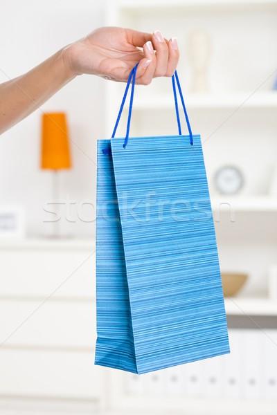 Stock photo: Female hand holding shopping bag