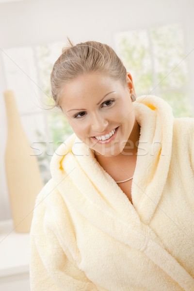 Młoda kobieta kąpielowy szlafrok portret szczęśliwy żółty Zdjęcia stock © nyul