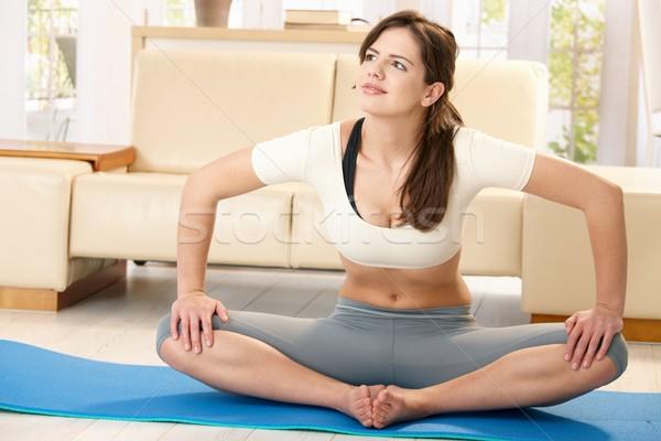 Stok fotoğraf: Kız · egzersiz · ev · oturma · mavi