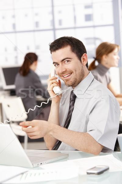 Stock fotó: Boldog · üzletember · laptopot · használ · beszél · telefon · ül