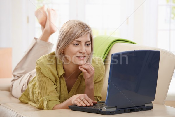 Woman browsing internet at home Stock photo © nyul