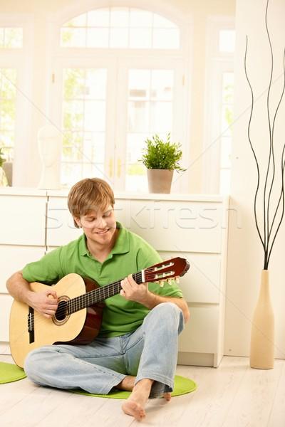 Guy playing guitar Stock photo © nyul