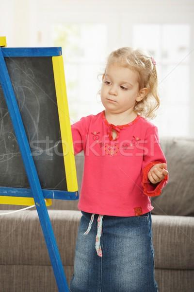 Petite fille planche à dessin bord dessin maison fille Photo stock © nyul