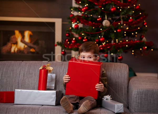 Little boy hiding behind gift box at christmas Stock photo © nyul