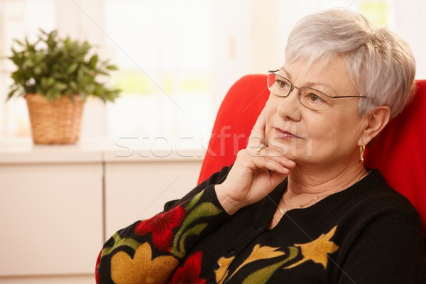 Stock photo: Senior woman daydreaming