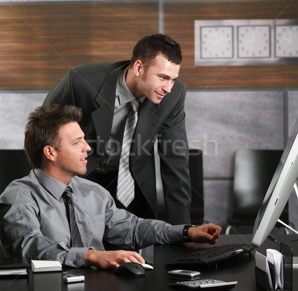 Stock photo: Businessmen working with computer