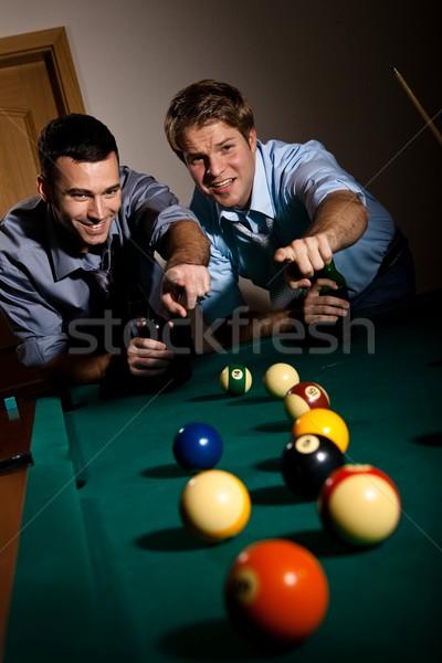 Férfiak mutat snooker labda kettő fiatal férfiak Stock fotó © nyul